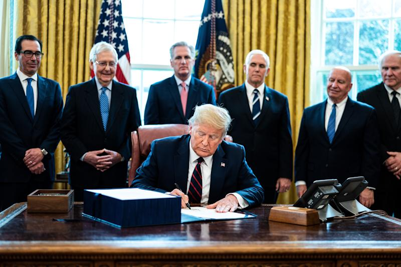 U.S. President Donald Trump signs H.R. 748, the CARES Act in the Oval Office of the White House on March 27, 2020 in Washington, D.C. (Photo: Pool via Getty Images)