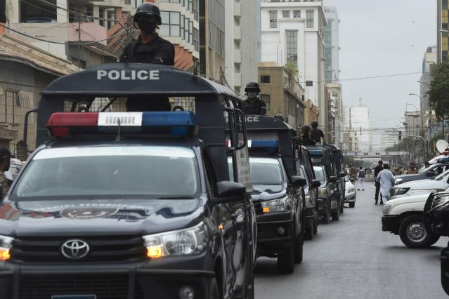 Policemen patrol near the Pakistan Stock Exchange building following an attack by gunmen in Karachi on June 29, 2020. - At least six people were killed when gunmen attacked the Pakistan Stock Exchange in Karachi on June 9, with a policeman among the dead after the assailants opened fire and hurled a grenade at the trading floor, authorities said. (Photo by Asif HASSAN / AFP) (Photo by ASIF HASSAN/AFP via Getty Images)