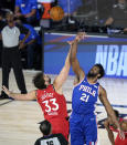 Toronto Raptors' Marc Gasol (33) and Philadelphia 76ers' Joel Embiid (21) go up for the opening tipoff during the first half of an NBA basketball game Wednesday, Aug. 12, 2020 in Lake Buena Vista, Fla. (AP Photo/Ashley Landis, Pool)