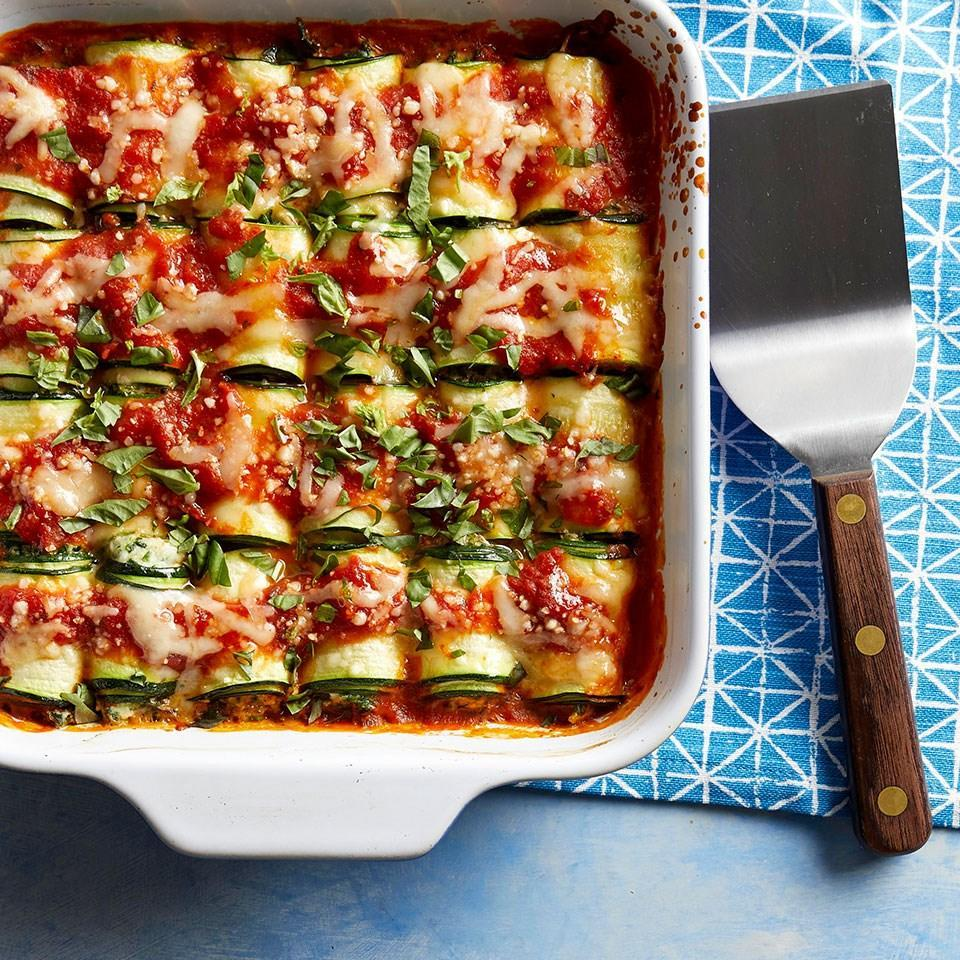<p>This healthy riff on lasagna rolls uses strips of zucchini instead of lasagna noodles for a vegetable-packed dinner that's fun for the whole family. This is a great recipe for kids to help make--let them get their hands dirty rolling the zucchini ribbons with the cheesy filling. Use a vegetable peeler or mandoline to quickly slice the zucchini into uniform thin strips--this will ensure easy rolling and even cooking.</p>