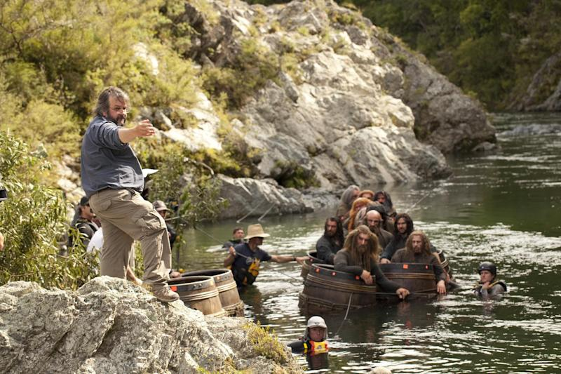 """This image released by Warner Bros. Pictures shows director Peter Jackson, left, during the filming of """"The Hobbit: The Desolation of Smaug."""" When Jackson released the first of his three """"Hobbit"""" films last year, he trumpeted the film's double-speed frame rate as a major innovation for moviemaking. With the release Friday of his """"The Hobbit: The Desolation of Smaug,"""" Jackson is being much quieter on the film's 48 frames-per-second, with the hopes that the movie's story won't be overshadowed by technology. (AP Photo/Warner Bros. Pictures, James Fisher)"""