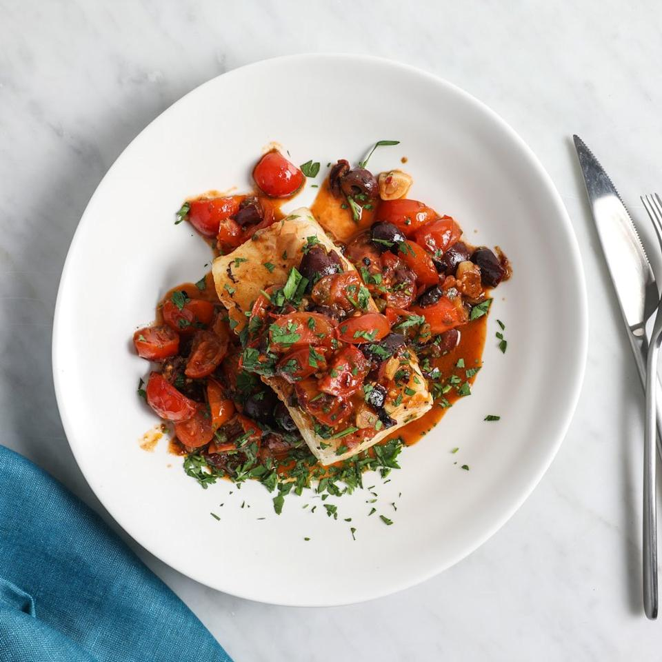 "<p>Debi Mazar and Gabriele Corcos riff on classic Southern Italian puttanesca with their Sicilian Cherry Tomato Sauce, here made with fresh tomatoes. The recipe calls for wild sea bass, but Mazar and Corcos like to make it with almost any fish, especially rich and oily ones like mackerel or bluefish.</p><p><a href=""https://www.foodandwine.com/recipes/sea-bass-sicilian-cherry-tomato-sauce"">GO TO RECIPE</a></p>"