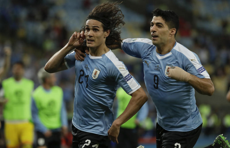 Uruguay's Edinson Cavani, left, celebrates with teammate Luis Suarez after scoring his side's opening goal during a Copa America Group C soccer match against Chile at the Maracana stadium in Rio de Janeiro, Brazil, Monday, June 24, 2019. (AP Photo/Leo Correa)