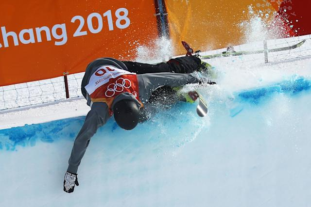 Joel Gisler of Switzerland hit the top of the wall during thehalfpipe event at the Winter Olympics.