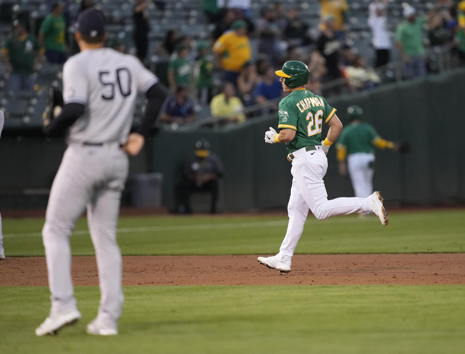 Oakland Athletics' Matt Chapman (26) runs the bases after hitting a solo home run off New York Yankees starting pitcher Jameson Taillon (50) during the third inning of a baseball game Thursday, Aug. 26, 2021, in Oakland, Calif. (AP Photo/Tony Avelar)