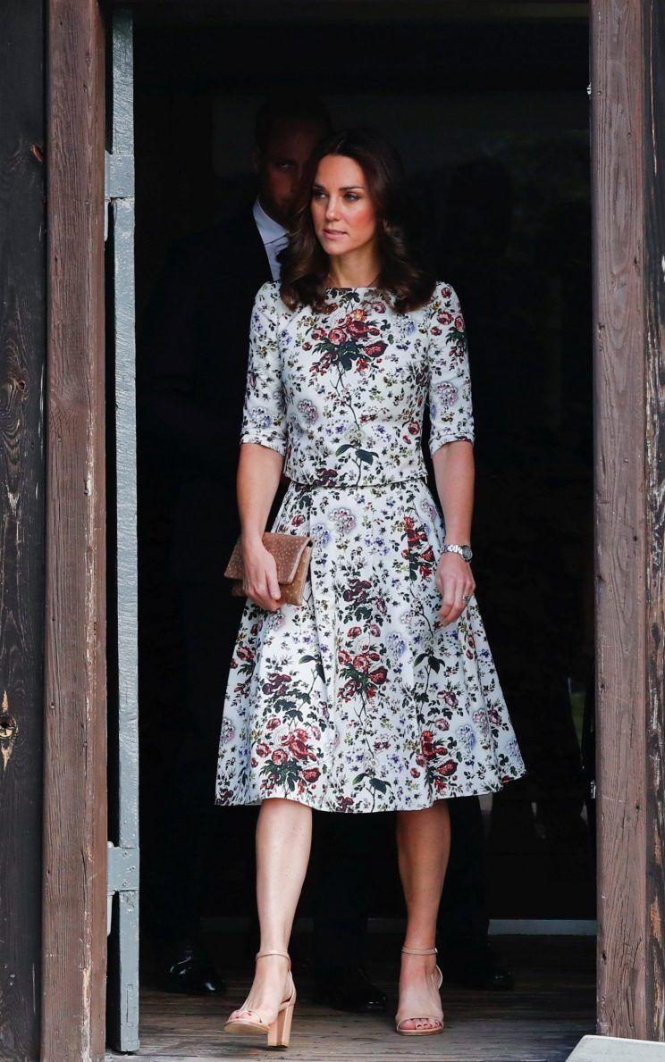 <p>For a sombre visit to a concentration camp, Kate dressed conservatively in a floral midi dress by London-based designer Erdem. She added a touch of diplomacy with a clutch by Polish label Etui.<br><i>[Photo: Getty]</i> </p>