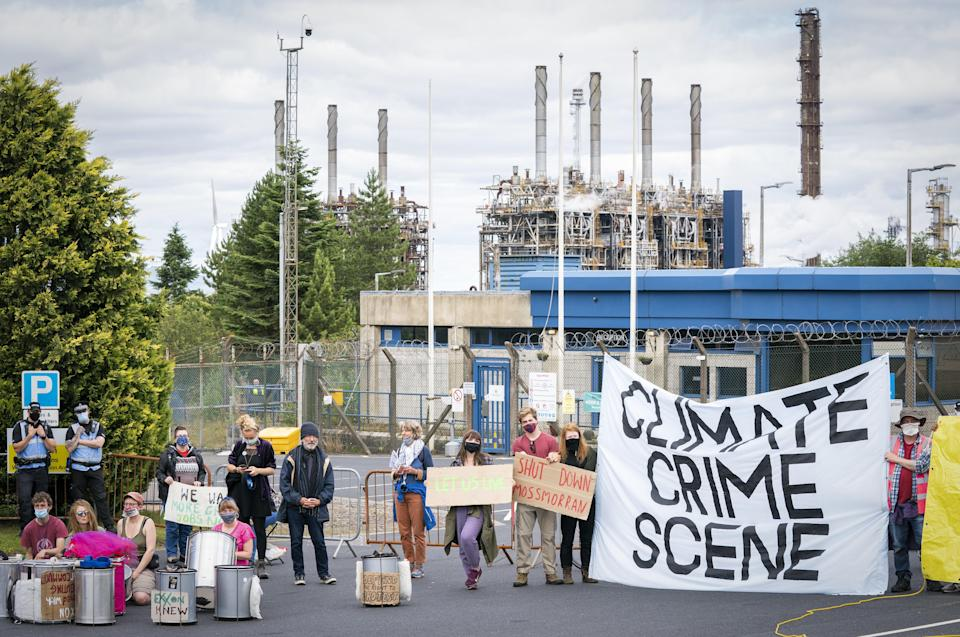 Climate activists demonstrating outside the gates of the Mossmorran chemical plant in Fife (Jane Barlow/PA) (PA Wire)