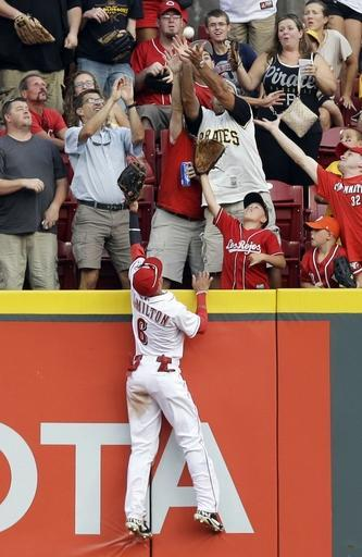 Cincinnati Reds center fielder Billy Hamilton (6) can't reach a solo home run hit by Pittsburgh Pirates' Andrew McCutchen in the fourth inning of a baseball game, Friday, July 11, 2014, in Cincinnati. (AP Photo/Al Behrman)