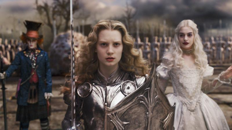 """Young Alice (Mia Wasikowska, center) leads the troops, including Mad Hatter (Johnny Depp) and the White Queen (Anne Hathaway), in """"Alice in Wonderland."""""""