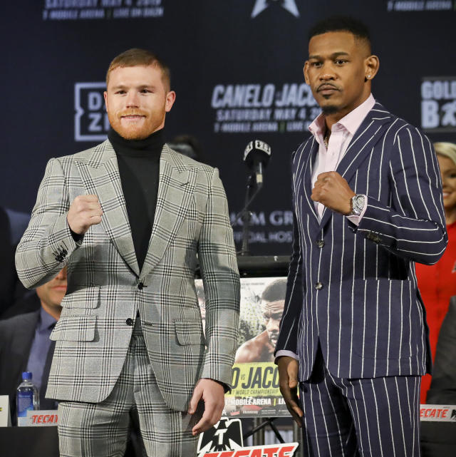 WBC and WBA middleweight world champion Canelo Alvarez (50-1-2, 34 KOs), left, and IBF middleweight world champion Daniel Jacobs (35-2, 29 KOs), right, pose with clenched fists during a pre-fight press conference on Wednesday Feb. 27, 2019, in New York. Alvarez and Jacobs meet in a 12-round unification bout in Las Vegas, Nevada, on Saturday May, 4, 2019. (AP Photo/Bebeto Matthews)