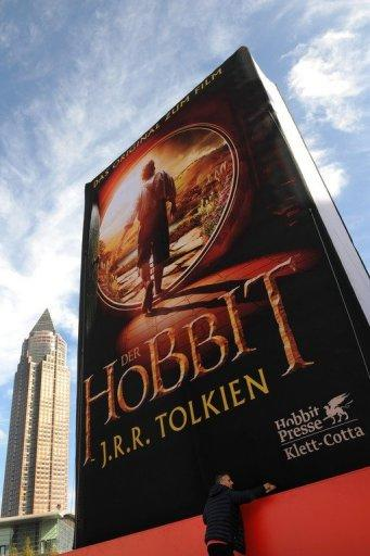 """An inflatable balloon featuring the cover of J.R.R. Tolkien's book """"The Hobbit"""" is displayed at a book fair in Germany. Animal rights group PETA said up to 27 animals, including horses, sheep, goats and chickens, died during the filming of """"The Hobbit"""" in New Zealand"""