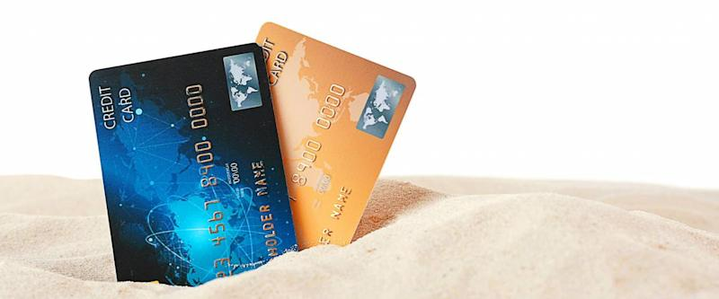Credit cards in sand on white background