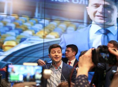 Ukrainian presidential candidate Volodymyr Zelenskiy reacts following the announcement of the first exit poll in a presidential election at his campaign headquarters in Kiev, Ukraine April 21, 2019. REUTERS/Viacheslav Ratynskyi