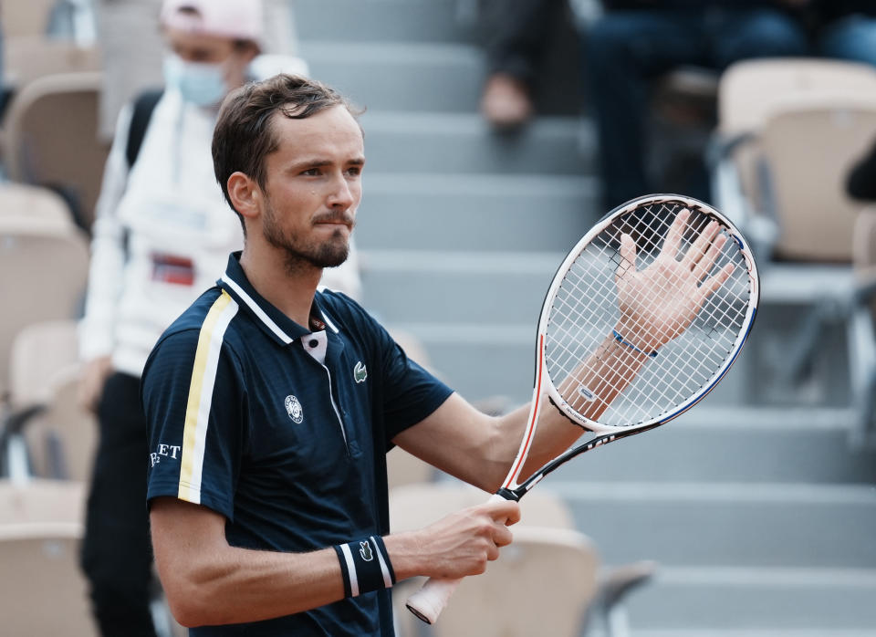 Russia's Daniil Medvedev celebrates after defeating United States's Reilly Opelka during their third round match on day 6, of the French Open tennis tournament at Roland Garros in Paris, France, Friday, June 4, 2021. (AP Photo/Thibault Camus)