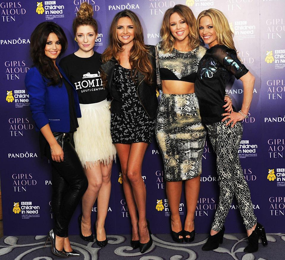 Cheryl Cole, Nicola Roberts, Nadine Coyle, Kimberley Walsh and Sarah Harding of Girls Aloud pose at a press conference to announce 'Girls Aloud Ten, The Hits Tour 2013' at The Corinthia Hotel on October 19, 2012 in London, England.