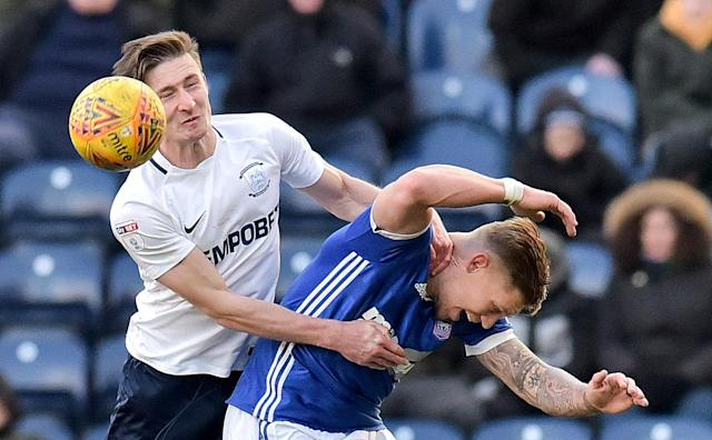 """Soccer Football - Championship - Preston North End vs Ipswich Town - Deepdale, Preston, Britain - February 24, 2018 Preston's Ben Davies in action with Ipswich Town's Martyn Waghorn Action Images/Paul Burrows EDITORIAL USE ONLY. No use with unauthorized audio, video, data, fixture lists, club/league logos or """"live"""" services. Online in-match use limited to 75 images, no video emulation. No use in betting, games or single club/league/player publications. Please contact your account representative for further details."""
