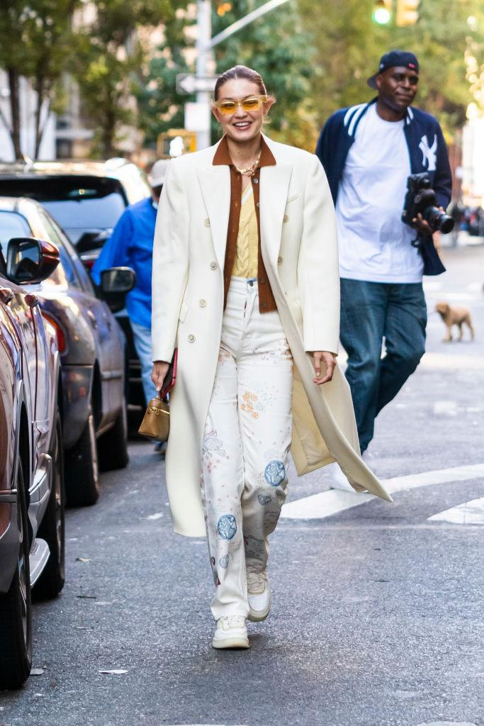 Gigi Hadid strolled through New York City in Reformation printed jeans. (Photo by Gotham/GC Images)