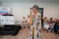 """Dina Jacobs performs a song called """"Home,"""" made famous by Diana Ross in the 1978 musical """"The Wiz,: during the opening of the Law Harrington Senior Living Center in Houston, Texas"""