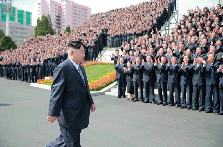 North Korean leader Kim Jong-Un (C) attending a photo session with the participants in the Seventh Congress of the Workers' Party of Korea at an undisclosed location