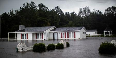 A house is seen flooded by rain after Hurricane Florence swept through the town of Wallace, North Carolina, U.S., September 15, 2018. REUTERS/Eduardo Munoz