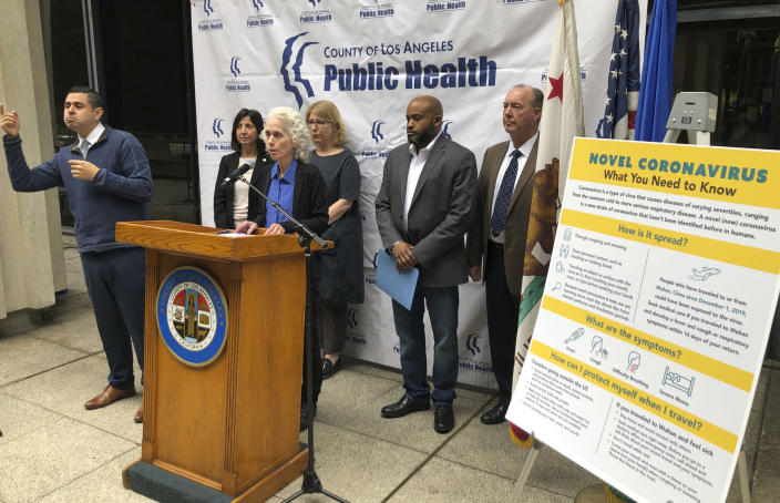 Dr. Sharon Balter, at podium with the Los Angeles County Department of Public Health officials, confirms a patient was taken to a hospital with Coronavirus symptoms at a news conference in Los Angeles Sunday, Jan. 26, 2020. The U.S. has several confirmed cases of the new virus from China, all among people who traveled to the city at the center of the outbreak, health officials said Sunday. (AP Photo/Chris Weber)