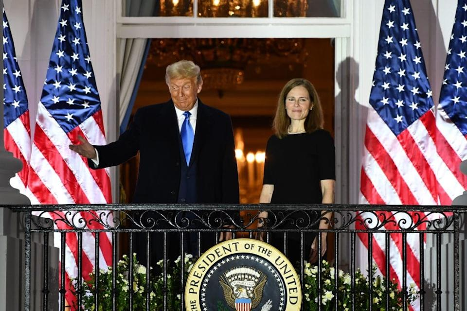 Donald Trump and Amy Coney Barrett stood on a White House balcony