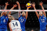 China's Gong Xiangyu, from left, China's Yan Ni and China's Li Yingying block a shot by United States' Michelle Bartsch-Hackley during the women's volleyball preliminary round pool B match between China and United States at the 2020 Summer Olympics, Tuesday, July 27, 2021, in Tokyo, Japan. (AP Photo/Frank Augstein)