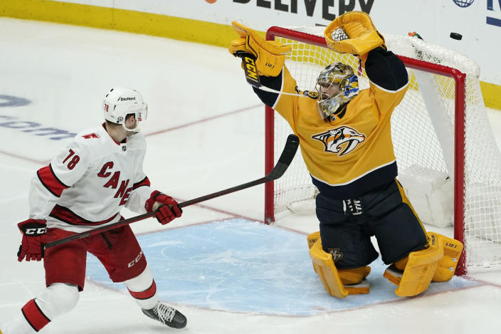 Nashville Predators goaltender Juuse Saros (74) reaches for a shot as Carolina Hurricanes center Steven Lorentz (78) watches for the rebound during the first overtime in Game 4 of an NHL hockey Stanley Cup first-round playoff series Sunday, May 23, 2021, in Nashville, Tenn. (AP Photo/Mark Humphrey)