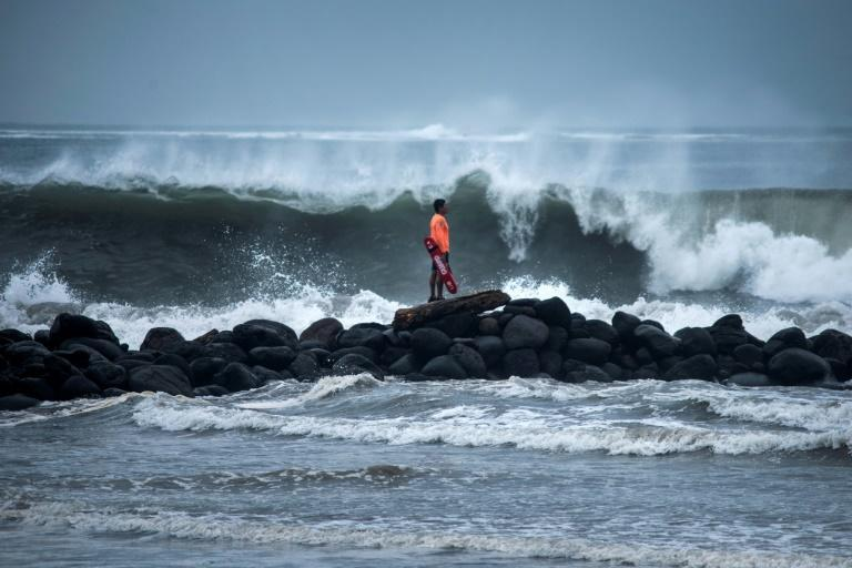 A lifeguard watches waves crashing on the shore in Boca del Rio in Mexico's eastern state of Veracruz as Hurricane Grace nears