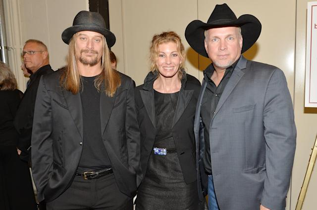 NASHVILLE, TN - MAY 02: (EXCLUSIVE COVERAGE) (L-R) Country musicians Kid Rock, Faith Hill, and Garth Brooks attend the funeral service for George Jones at The Grand Ole Opry on May 2, 2013 in Nashville, Tennessee. Jones passed away on April 26, 2013 at the age of 81. (Photo by Rick Diamond/Getty Images for GJ Memorial)