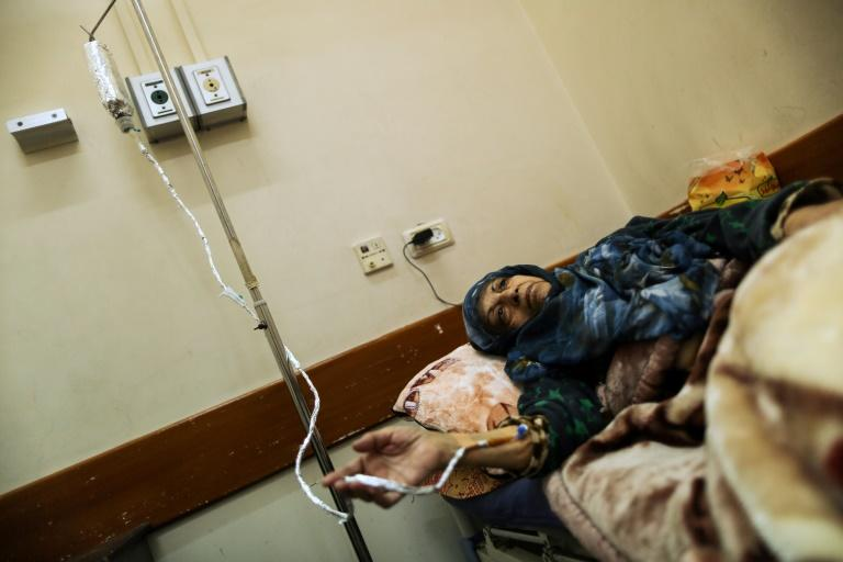 A Palestinian woman suffering from cancer receives treatment at a hospital in Gaza City on February 13, 2018