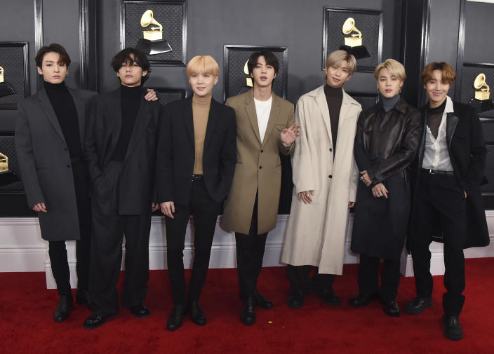 "FILE - In this Jan. 26, 2020, file photo, South Korean K-pop band BTS arrives for the 62nd annual Grammy Awards in Los Angeles. BTS released a statement condemning racism against Asians and Asian Americans and Pacific Islanders (AAPI) on Tuesday, March 30, 2021. ""We stand against racial discrimination,"" the biggest boyband in the world, tweeted to their 34 million followers in both English and Korean. (Photo by Jordan Strauss/Invision/AP, File)"
