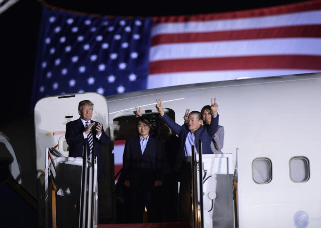 President Donald Trump, from left, greets Tony Kim, Kim Hak Song, seen in the shadow, and Kim Dong Chul, three Americans detained in North Korea for more than a year, as they arrive at Andrews Air Force Base in Md., Thursday, May 10, 2018. First lady Melania Trump also greet them at right. (AP Photo/Susan Walsh)