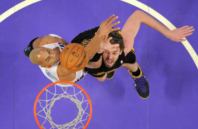 Charlotte Bobcats guard Gerald Henderson, left, defendsLos Angeles Lakers center Pau Gasol during the first half of an NBA basketball game, Friday, Jan. 31, 2014, in Los Angeles. (AP Photo/Mark J. Terrill)