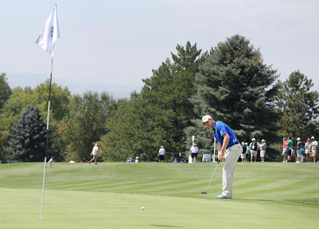 Justin Rose, of England, putts on the ninth hole during the first round of the BMW Championship golf tournament at Cherry Hills Country Club in Cherry Hills Village, Colo., Thursday, Sept. 4, 2014. (AP Photo/Brennan Linsley)