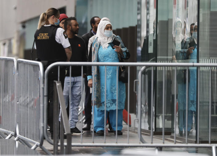 Family and survivors from the March 2019 Christchurch mosque shootings arrive outside the Christchurch High Court for the sentencing of twenty-nine-year-old Australian Brenton Harrison Tarrant, in Christchurch, New Zealand, Monday, Aug. 24, 2020. Tarrant has pleaded guilty to 51 counts of murder, 40 counts of attempted murder and one count of terrorism in the worst atrocity in the nation's modern history. (AP Photo/Mark Baker)