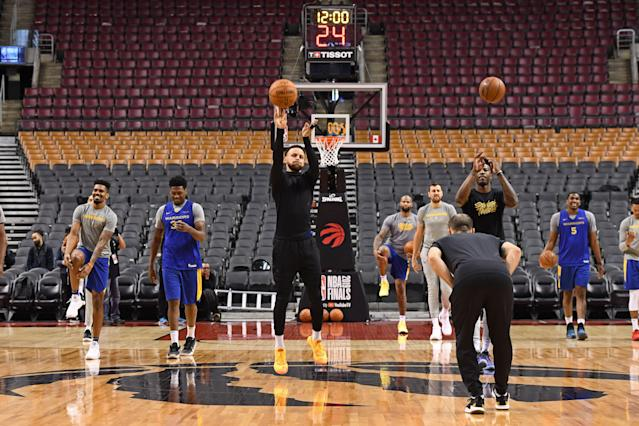 Stephen Curry shoots a halfcourt shot during NBA Finals practice in Toronto on Wednesday. (Photo by Garrett Ellwood/NBAE via Getty Images)