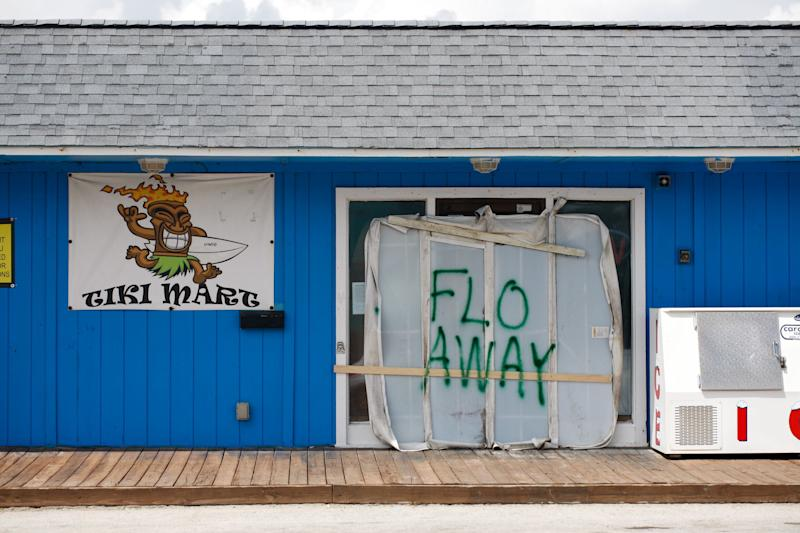 A Tiki bar sits empty with the message 'FLO AWAY' on Tuesday on Topsail Island, North Carolina.