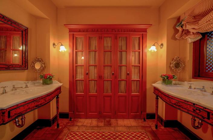"""<p>The doors leading to the toilets in this main-floor """"ladies' powder room"""" may remind you of a confessional booth. There's a reason for that. (Photo by Steve Brown/Sepia Productions)</p>"""