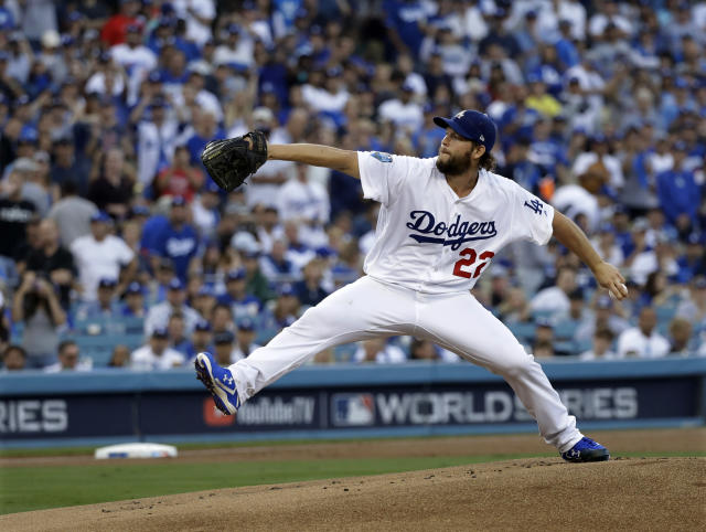 FILE - In this Oct. 28, 2018, file photo, Los Angeles Dodgers pitcher Clayton Kershaw winds up during the first inning in Game 5 of the World Series baseball game against the Boston Red Sox, in Los Angeles. Kershaw, one of the game's elite pitchers, anchors a deep rotation that is key to the Dodgers continued success. (AP Photo/David J. Phillip, File)