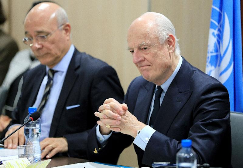 UN Special Envoy for Syria Staffan de Mistura (R) attends a meeting of Intra-Syria peace talks with Syrian government delegation at the Palais des Nations in Geneva on February 25, 2017 (AFP Photo/Pierre ALBOUY)