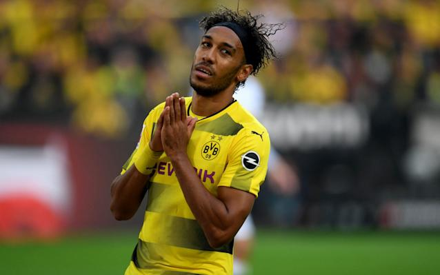 "Arsenal's £60 million pursuit of Pierre-Emerick Aubameyang has descended into acrimony and anger after Borussia Dortmund dropped their star player and accused Arsene Wenger of disrespecting their club. Wenger had begun the day by largely dodging questions on the potential club record acquisition of Aubameyang before responding to an inquiry about his character and whether he would fit in at Arsenal. ""Yes,"" said Wenger, ""because character can be a very positive note and it can be a very negative note. I believe overall you look at the achievements of a player during his career and usually, when a career has been very positive, the character has been used in a positive way."" Those comments soon prompted a furious reaction from Dortmund, who told Wenger to focus on his own struggling team and then left the 28-year-old Gabon striker out of the squad for Friday night's Bundesliga match against Hertha Berlin. Aubameyang was also excluded from last Sunday's match against Wolfsburg after missing a team meeting and, while Arsenal are now closing on a deal that could also involve Olivier Giroud, Dortmund are deeply unhappy at how their player has become unsettled. Zorc isn't at all happy with Wenger Credit: Getty images ""We find it disrespectful to speak about players of other clubs,"" said Michael Zorc, Dortmund's sporting director, in an official club statement. ""We assumed that Arsene Wenger would have enough to do to take care of the performances of his own players."" Arsenal have won just one of their last six matches to fall eight points off even the top four and are ready to offer Aubameyang a contract until 2021. No fee has yet been agreed with Dortmund but, following the departures already this month of Francis Coquelin and Theo Walcott, as well Alexis Sanchez's imminent move to Manchester United, Giroud could be the next major exit. Dortmund were also keen on Giroud last summer and Wenger noticeably refused to rule out his departure this month. ""It can be many theories - at the moment I cannot tell you much more,"" he said rather cryptically, when asked whether Giroud, who has scored 105 goals across six seasons at Arsenal, could leave if Aubameyang came in. Aubameyang has scored 141 goals for Dortmund in four-and-a-half seasons, including 21 this campaign, and has the additional endorsement of Sven Mislintat, Arsenal's new head of recruitment. Mislintat moved from Dortmund to Arsenal in November and was previously instrumental in identifying Aubameyang when he moved to the Bundesliga from Saint-Etienne in 2013. Pierre-Emerick Aubameyang 