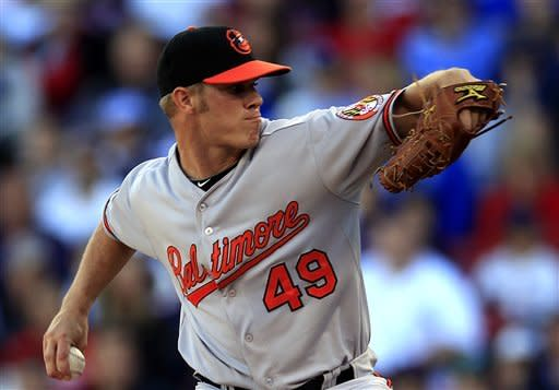 Baltimore Orioles' Dylan Bundy winds up for a pitch against the Boston Red Sox in the eighth inning of a baseball game at Fenway Park, in Boston, Sunday, Sept. 23, 2012. The Red Sox won 2-1. (AP Photo/Steven Senne)
