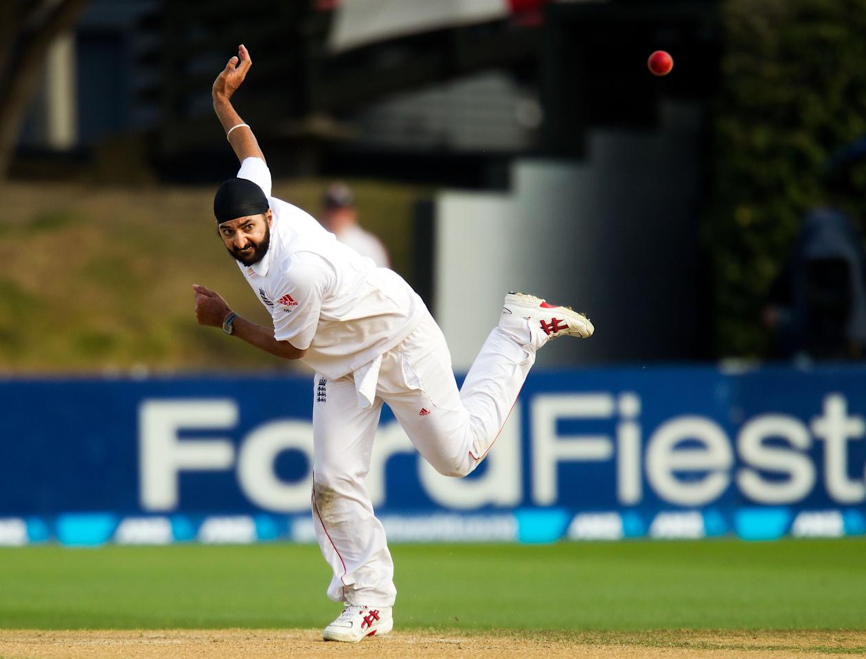 England's Monty Panesar bowls during day four of the international cricket Test match between New Zealand and England played at the Basin Reserve in Wellington on March 17, 2013.   AFP PHOTO / Marty MELVILLE        (Photo credit should read Marty Melville/AFP/Getty Images)