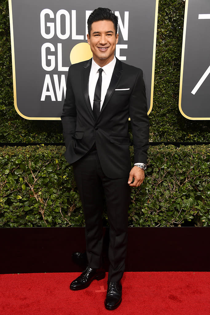 <p>The <em>Extra</em> host arrives at the 75th annual Golden Globes in Los Angeles. (Photo: Frazer Harrison/Getty Images) </p>
