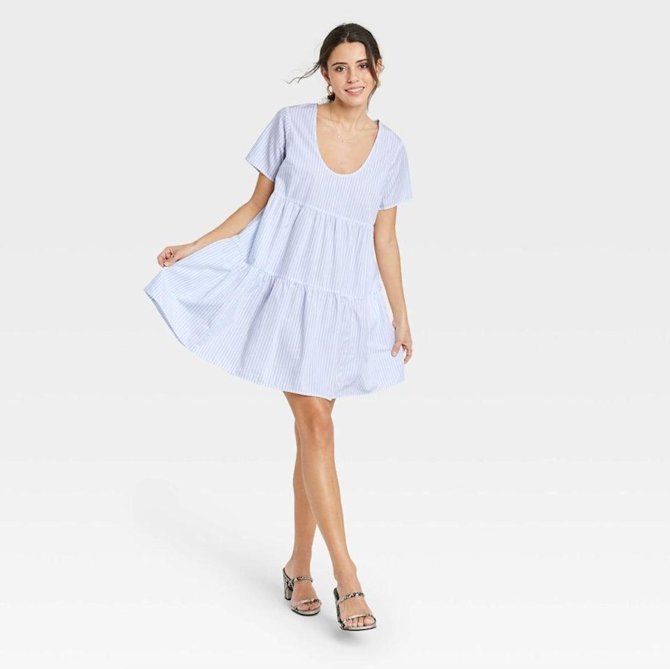 <p>If you love blue, then get the <span>A New Day Flutter Short Sleeve Tiered Dress in Blue Stripe</span> ($25). I can already see myself wanting it for my next beach day.</p>