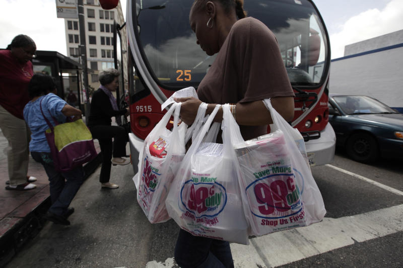 A woman carries her purchases in plastic bags in Los Angeles, Thursday, May 24, 2012. Now that the city of Los Angeles has taken the first step toward banning plastic bags, it appears the little utilitarian bags themselves may be headed for the trash heap of history. (AP Photo/Jae C. Hong)