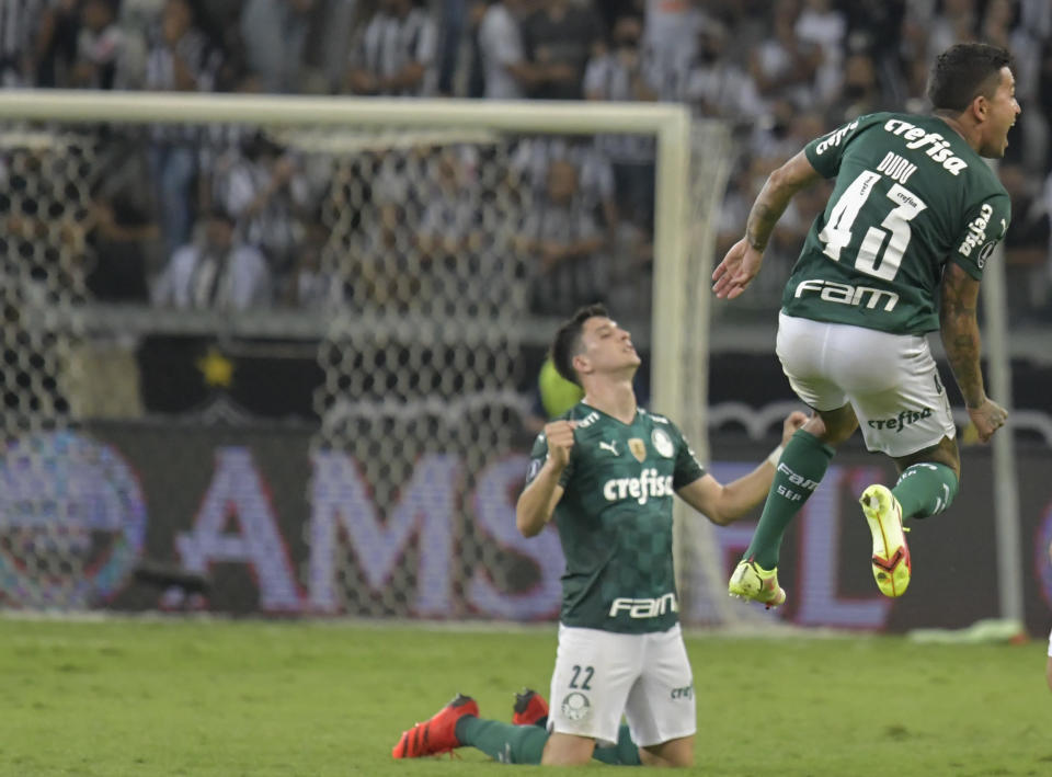 Dudu of Brazil's Palmeiras, right, and teammate Joaquin Piquerez celebrate at the end of a Copa Libertadores semifinal second leg soccer match against Brazil's Atletico Mineiro at the Mineirao stadium in Belo Horizonte, Brazil, Tuesday, Sept. 28, 2021. The match ended 1-1 on aggregate and Palmeiras advanced to the final due to an away goal. (Washington Alves/Pool via AP)