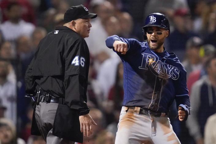 Tampa Bay Rays Kevin Kiermaier reacts after scoring on a double by Randy Arozarena during the eighth inning against the Boston Red Sox during Game 4 of a baseball American League Division Series, Monday, Oct. 11, 2021, in Boston. (AP Photo/Charles Krupa)