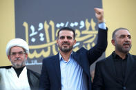 """Hussein Muanis, the leader of a political movement called """"Harakat Huqooq,"""" Arabic for Rights Movement, center, salutes his supporters at an election rally before the upcoming parliamentary elections in Baghdad, Iraq, Friday, Sept. 3, 2021. Muanis is the leader of Kataeb Hezbollah, one of the most hard-line and powerful militias with close ties to Iran, who once battled U.S. troops. He is the first to be openly affiliated with Kataeb Hezbollah or Hezbollah Brigades, signaling the militant group's formal entry into politics. (AP Photo/Hadi Mizban)"""